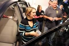 Grasping the van's title, Brandi still couldn't believe the van is hers.