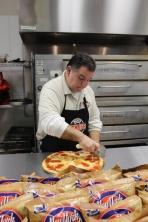 Jim Benjamin prepping a pizza.