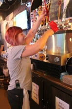 Jen Countryman pours some beer samples at Ploty's Hometown Tavern