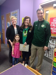 Cindy and Brooklyn with Plank North assistant principal Heather Balsamo and principal Craig Bodensteiner.
