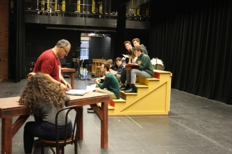 Director Sandy Nagar, left, works with the cast of Chicago at a recent rehearsal.
