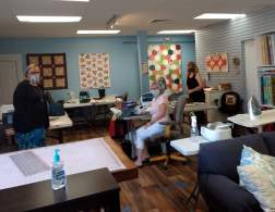 Working on projects at the Village Quilt Shoppe